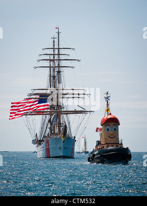Theodore Too leads USCGB Eagle during the 2012 Tall Ships festival in Halifax, Nova Scotia. - Stock Photo
