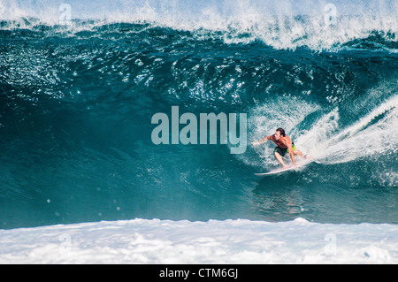 Surfing at Backdoor Pipeline, North Shore, Oahu, Hawaii Stock Photo