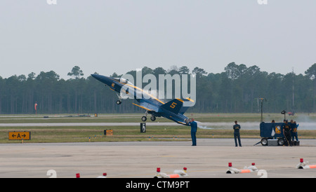 Lt C J Siminsen piloting his Boeing FA18 Hornet off the runway at NAS Pensacola USA - Stock Photo