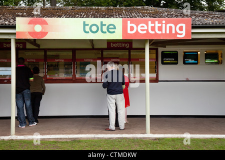 People betting on the horses at Tote Betting, newmarket racecourse, Suffolk UK - Stock Photo