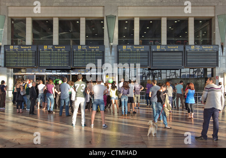 People waiting in the arrivals hall at El Prat Airport, Barcelona, Spain. - Stock Photo