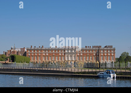 the 17th century christopher wren designed south side of hampton court palace, seen from across the river thames - Stock Photo