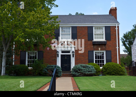 Red brick house with flag for Independence day in Oklahoma city, OK, USA - Stock Photo