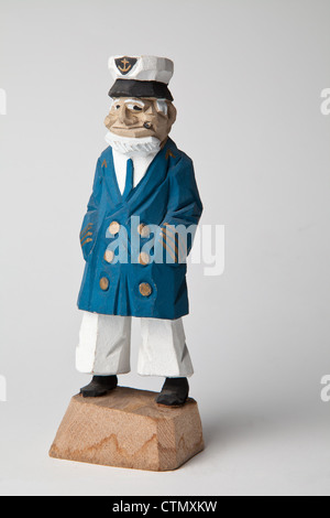 carved wooden sailors vintage kitch collectible sea navy captain sailor on white background fisherman European English - Stock Photo