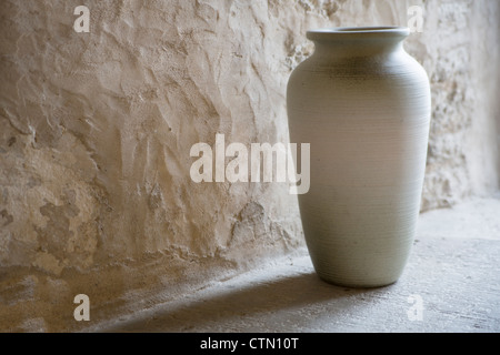 Handmade and smoothed vase in room corner - Stock Photo