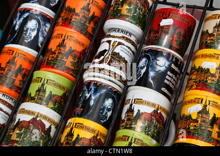 Dracula and Sighisoara Clock Tower coffee mugs seen in a shop in Sighisoara, Romania - Stock Photo