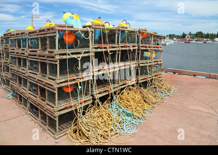 A pile of lobster traps stacked up on a wharf in rural Prince Edward Island, Canada. - Stock Photo