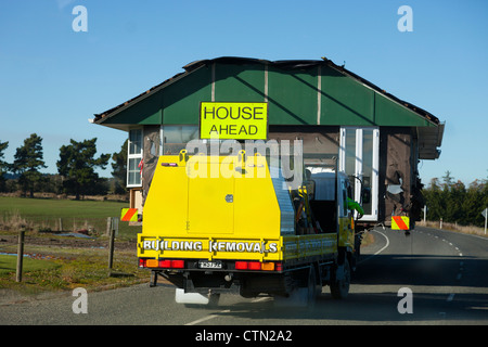 House-moving, Kiwi-style - a road in Central Otago, New Zealand - Stock Photo