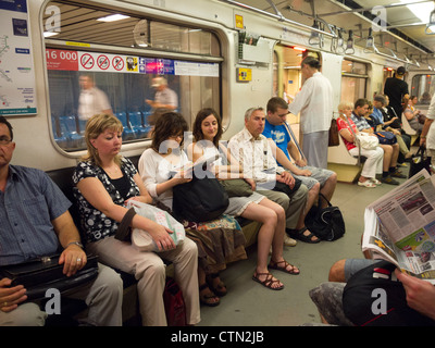 Passengers in an underground tube train, Budapest, Hungary, Eastern Europe - Stock Photo