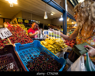 Fruit market stall in the Budapest great market hall in Budapest, Hungary, Eastern Europe - Stock Photo