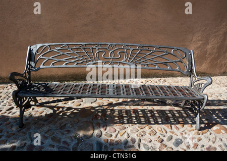 Old ornate forged iron street bench - Stock Photo