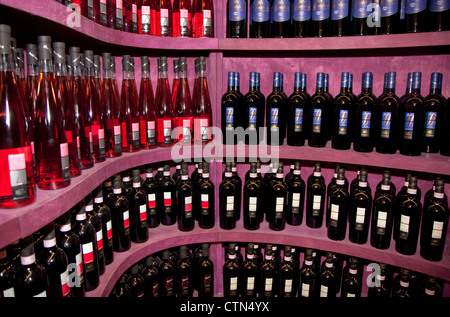 Bottles of Chianti and other wines on sale in winery near Florence, Italy - Stock Photo