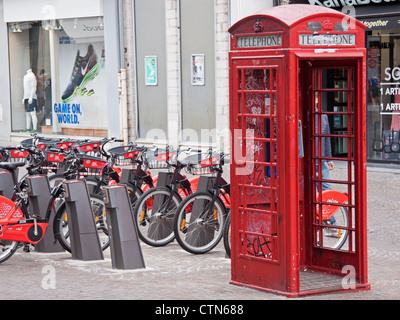 Traditional red British telephone box located in the unusual environment of a shopping mall in Lille, northern France - Stock Photo