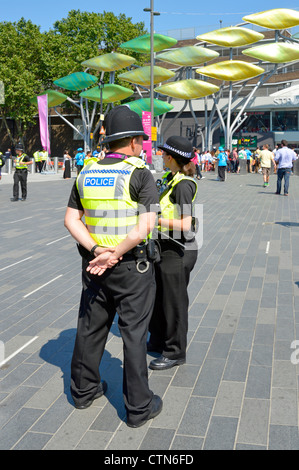 Police officers on duty at entrance concourse to the 2012 Olympic Park and the Westfield Stratford City shopping - Stock Photo