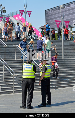 Police officers on duty at entrance steps to the 2012 Olympic Park and the Westfield Stratford City shopping centre - Stock Photo