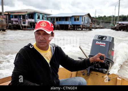 Water taxi driver in Kampong Ayer Bandar Seri Begawan Brunei Borneo Asia. - Stock Photo