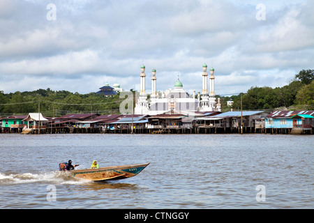 Water taxi with Kampong Ayer and a floating mosque in the background Bandar Seri Begawan Brunei. - Stock Photo