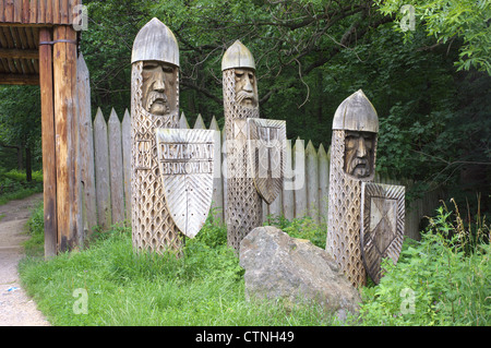 Wooden sculptures Bedkowice ancient Slavic dwelling Lower Silesia Poland - Stock Photo