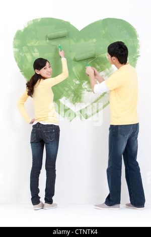 Young couple doing home DIY - Stock Photo