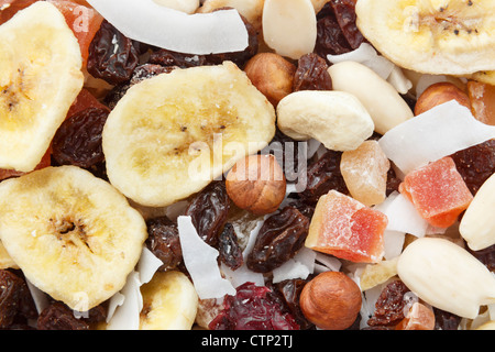 Mix of nuts and dried fruit pieces healthy high energy snack close-up - Stock Photo