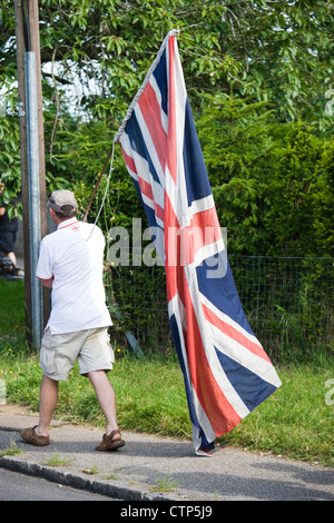 London 2012 Olympic Games. Man with Union Jack at men's cycle road race, Ripley, Surrey. - Stock Photo