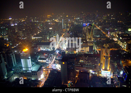 View of the Bangkok cityscape at night taken from the Baiyoke Tower II, Thailand. - Stock Photo