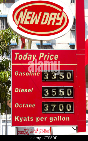 Automobile fuel prices in Kyat currency at a gas station in (Rangoon) Yangon, (Burma) Myanmar. - Stock Photo