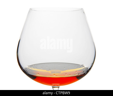 Cognac Snifter glass with liquid amber inside - Stock Photo