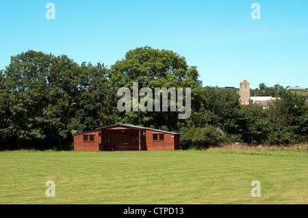 village cricket,clubhouse,grass, green, grounds, cricket, field, football, forest, garden, golf, grass, green, grounds, - Stock Photo