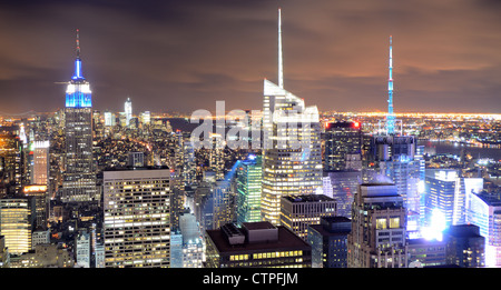 Famed New New York City skyscrapers in midtown Manhattan at night. - Stock Photo