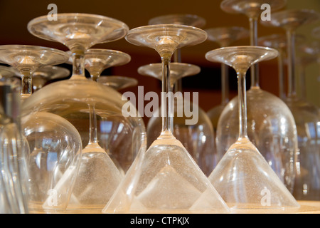 Empty different shape goblets stay on special shelf - Stock Photo