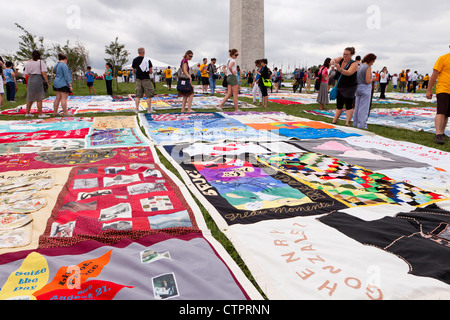 AIDS Memorial Quilt panels are put on display on the Mall to mark its 25th anniversary - July 22, 2012, Washington, - Stock Photo