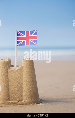 Union Jack flag in a sandcastle on a beach. Wells next the sea. Norfolk, England - Stock Photo