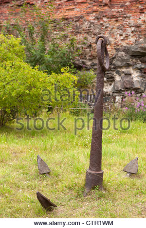An old anchor on ground at Suomenlinna -sea fortress. Helsinki, Finland. - Stock Photo