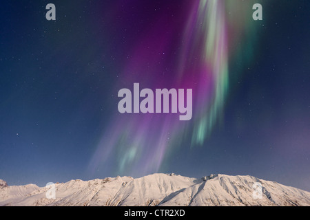 Northern Lights (aurora borealis) Big Dipper (Ursula Major) over Talkeetna Mountains in Hatcher Pass on clear cold - Stock Photo