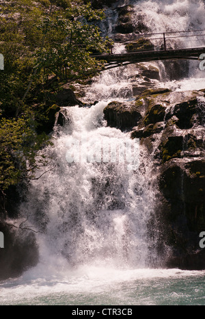 Giessbach Falls into Lake Brienz in Switzerland - Stock Photo