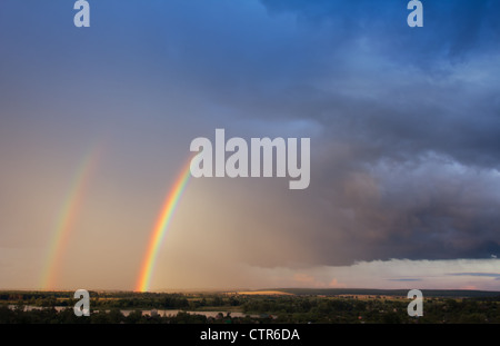 Double rainbow over lakes - Stock Photo