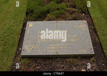 Stone marking the graves of Ukranian soldiers German Military Cemetery Cannock Chase Staffordshire UK - Stock Photo