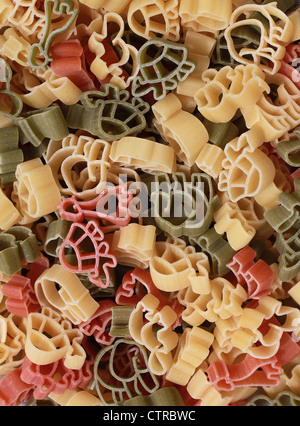 Italian pasta of durum wheat semolina with tomato and spinach in form of various zoo animals. Funny for children. - Stock Photo