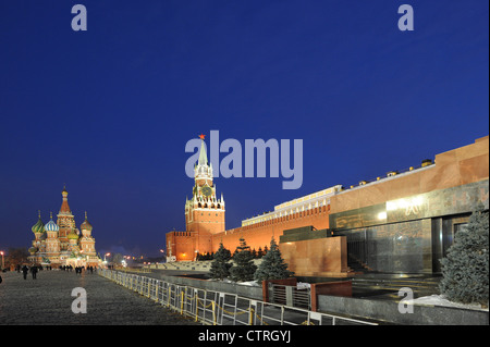 Saint Basil's cathedral,  Kremlin, and the Lenin mausoleum on red square during the evening in Moscow, Russia. - Stock Photo