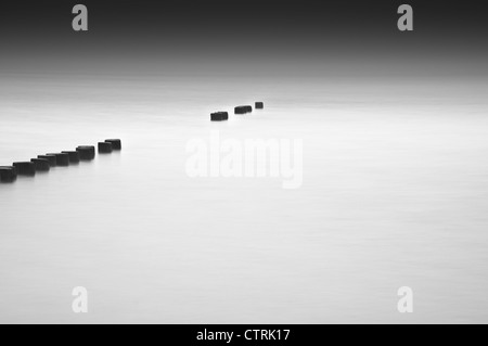 Old wooden groynes on a beach on the Baltic Sea - Stock Photo