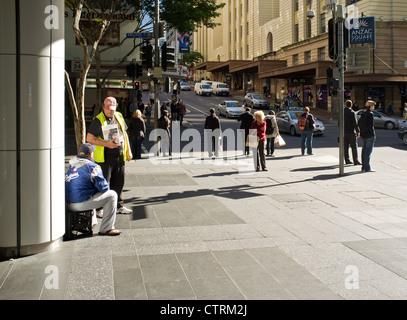 People on a street corner in Brisbane - Stock Photo
