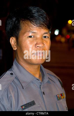 Burmese police officer in (Rangoon) Yangon, (Burma) Myanmar. - Stock Photo