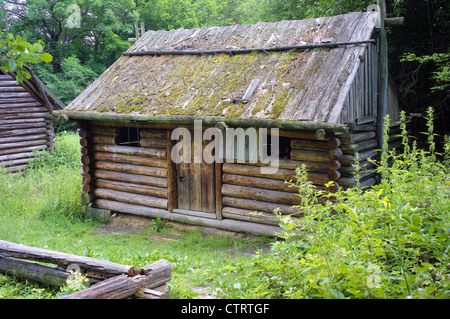 Wooden hut reconstruction Bedkowice ancient Slavic dwelling Lower Silesia Poland - Stock Photo