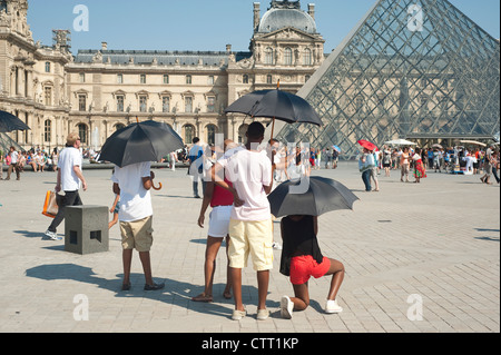 Paris, France  - A group of African tourists visiting the city around the Louvre Museum area. - Stock Photo