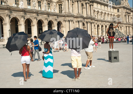 Paris, France  - A family  of African tourists visiting the city around the Louvre Museum area. - Stock Photo