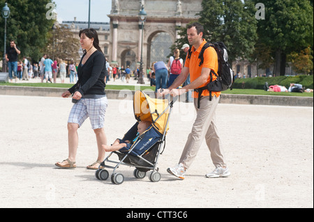Paris, France - A family  of tourists visiting the town. - Stock Photo