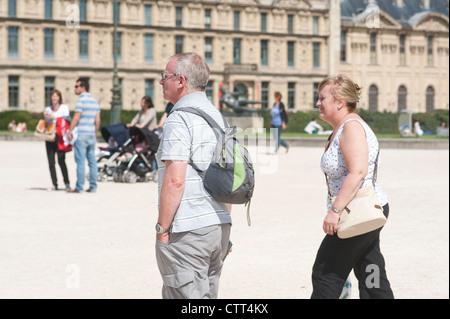 Paris, France - Mature adult couple visiting town. - Stock Photo