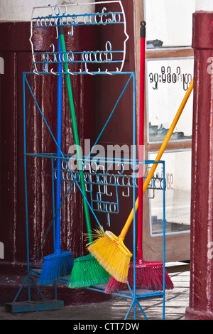 Myanmar, Burma. Colorful Brooms, Shwezigon (Shwezegon) Pagoda, Nyaung Oo, near Bagan. - Stock Photo