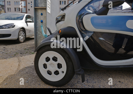 Renault Twizy electric city car heavy quadricycle ultra-compact vehicle charges batteries at a public charging station - Stock Photo